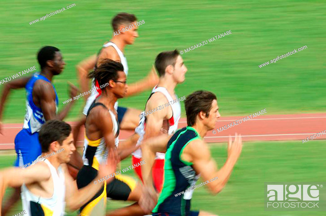 Stock Photo: Male Runners Sprinting Down Track.