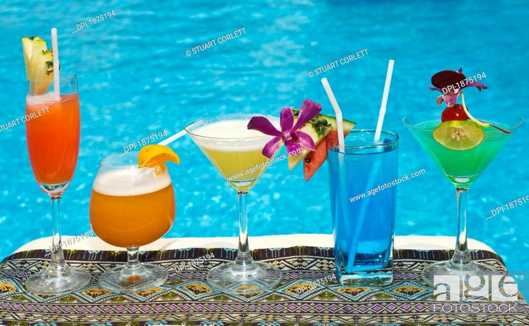 Stock Photo: chiang mai, thailand, tropical drinks by the pool at horizon resort.