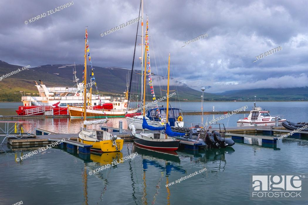 Stock Photo: Port in Akureyri city, Capital of North Iceland, view with Elding Whale Watching boat Holmasol.