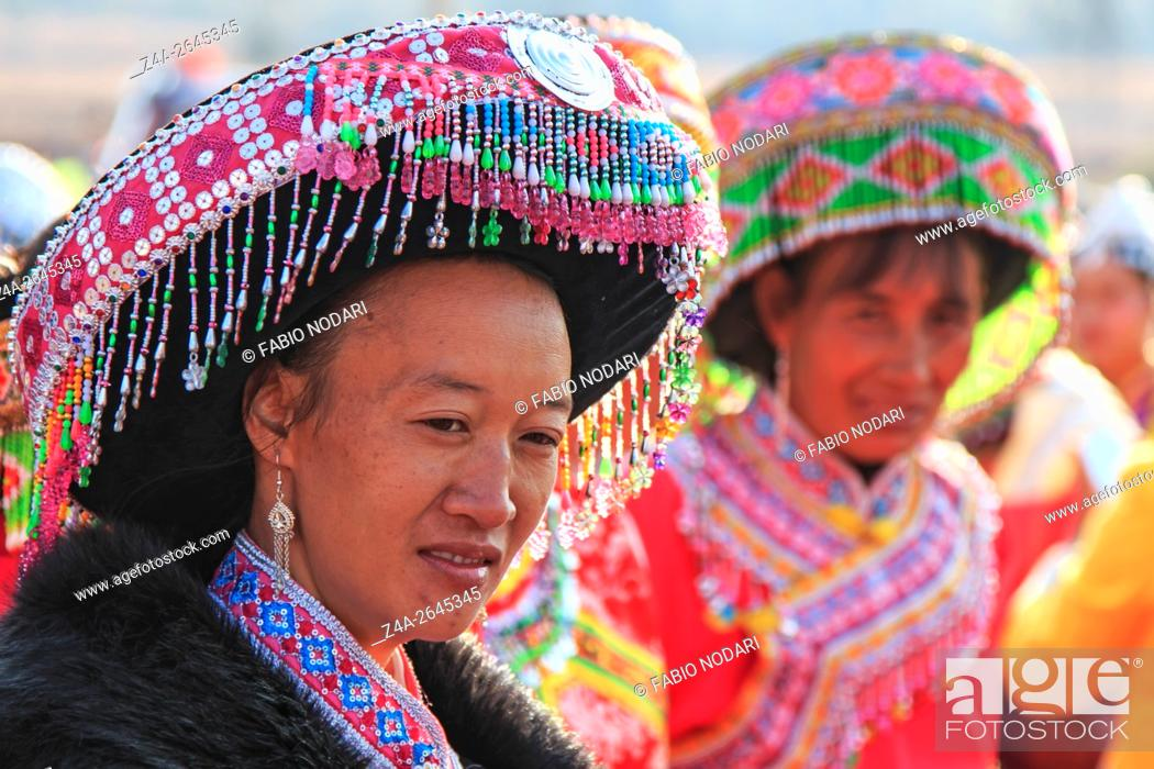 Stock Photo: Heqing, China - March 15, 2016: Chinese woman in traditional Miao attire during the Heqing Qifeng Pear Flower festival.