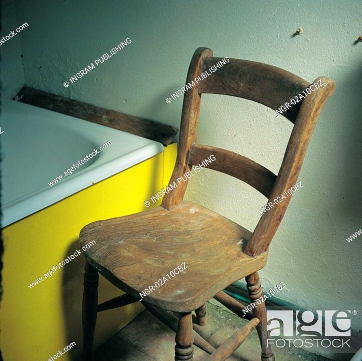 Stock Photo: chair kept in the bathroom.