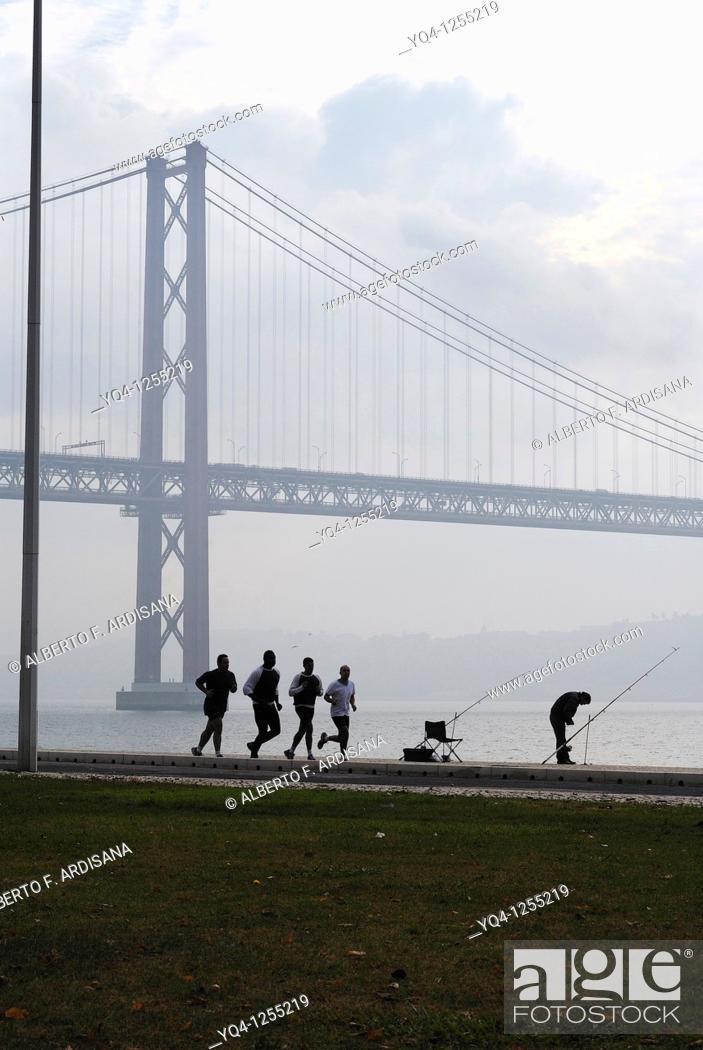 Stock Photo: Running along the river Tejo, Lisbon, Portugal.