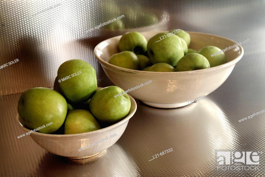 Stock Photo: Green apples inside two white bowls.