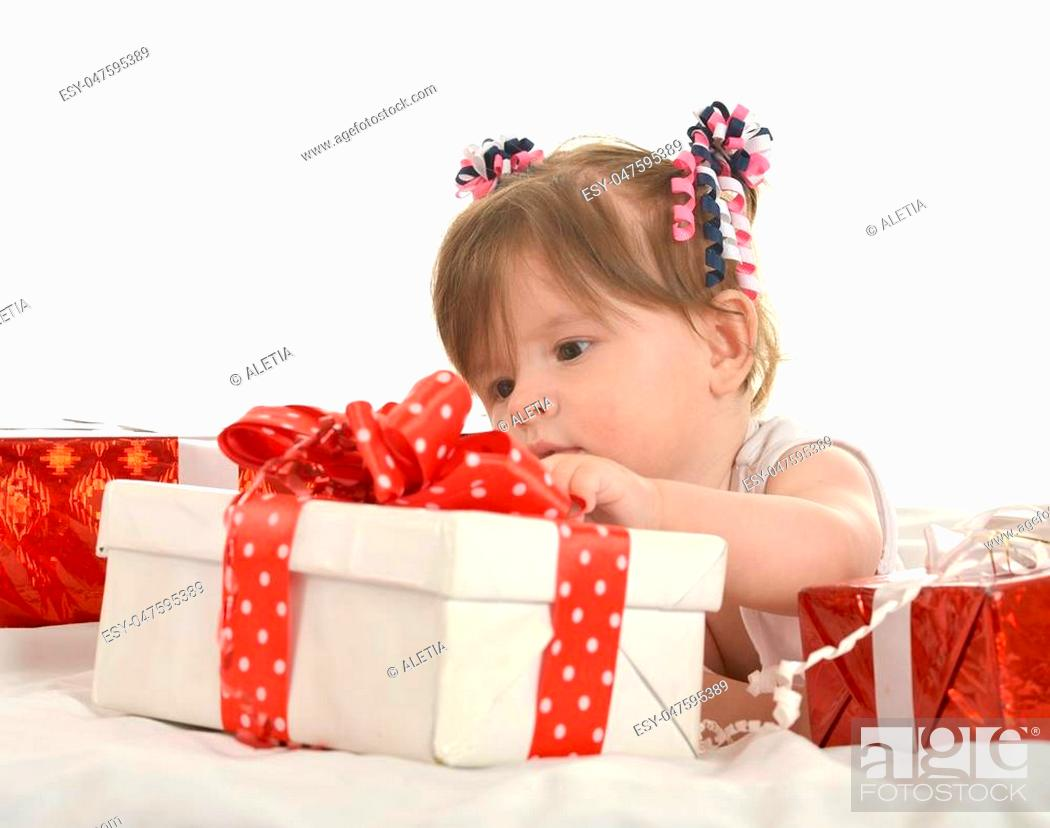 Stock Photo: Portrait of Cute baby girl with gifts.