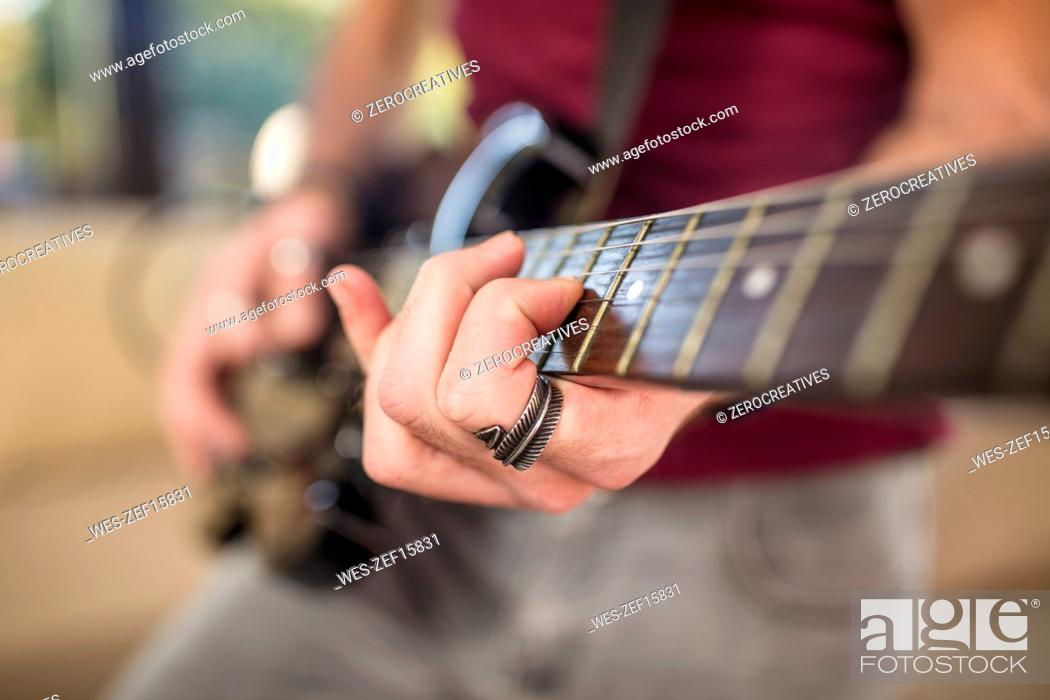 Stock Photo: Close-up of man's hand playing electric guitar.