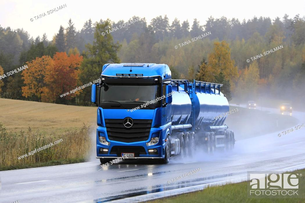 Stock Photo: Blue Mercedes-Benz Actros tank truck of Kuljetusliike Markus Hanninen Oy delivers load along wet road on a rainy day. Salo, Finland. October 4, 2019.