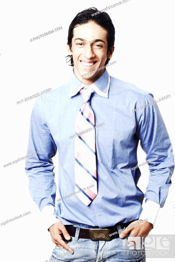 Stock Photo: Portrait of a young man with his hands in his pockets.