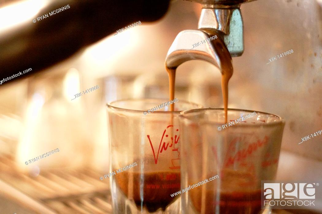 Stock Photo: A pair of espresso shots being poured.