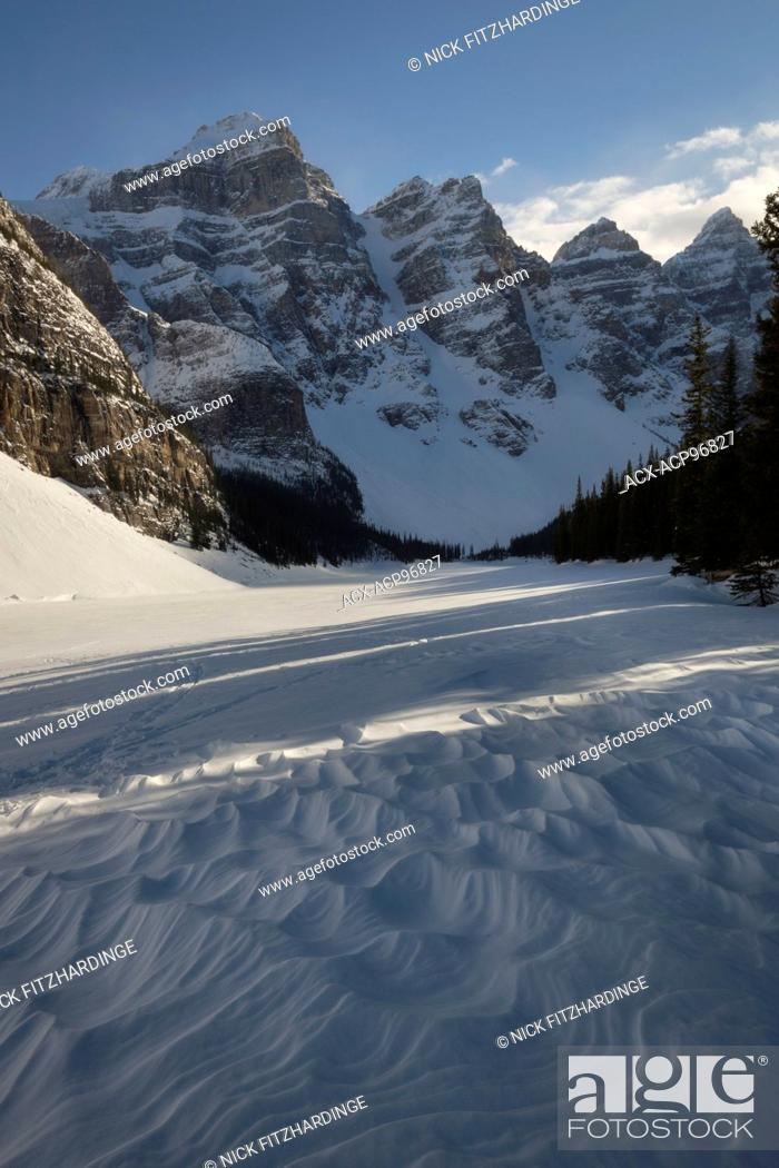 A Frozen Snow Covered Moraine Lake In Winter Banff National