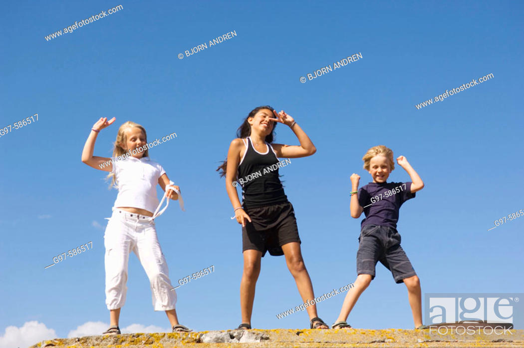 Stock Photo: Three kids outdoors. The Baltic sea. Sweden.
