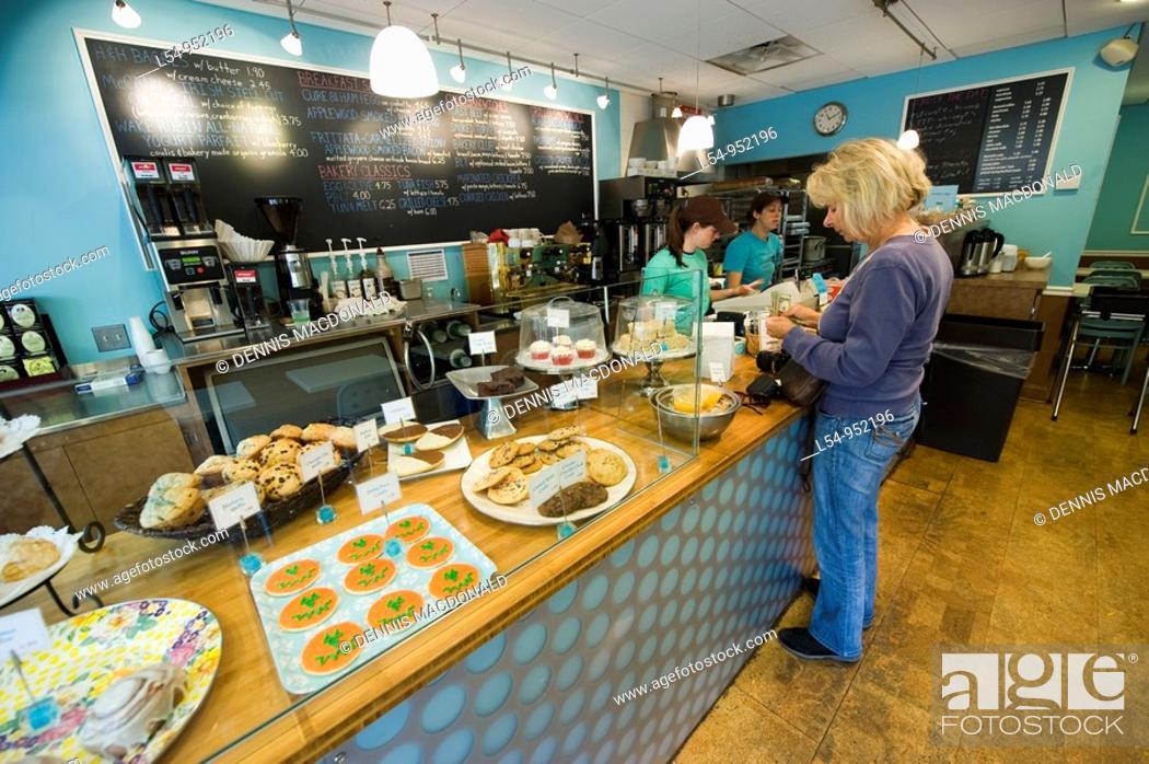 Stock Photo: Caucasian woman purchases food in Skaneateles New York Finger Lakes Region bakery.