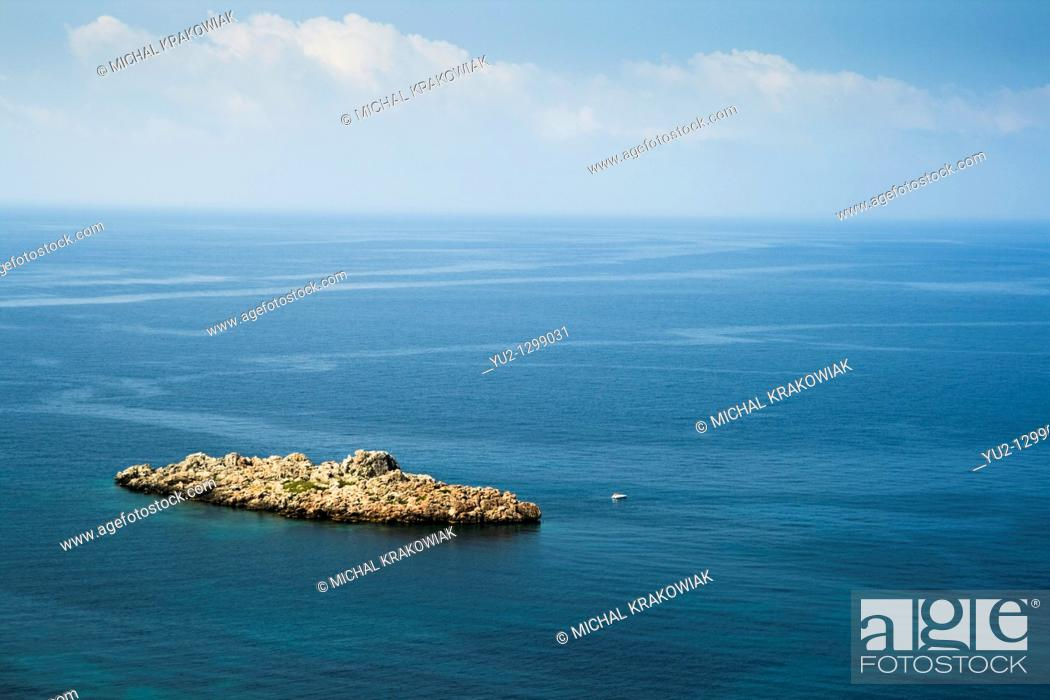 Stock Photo: Rocky islet on the coast of Montenegro.