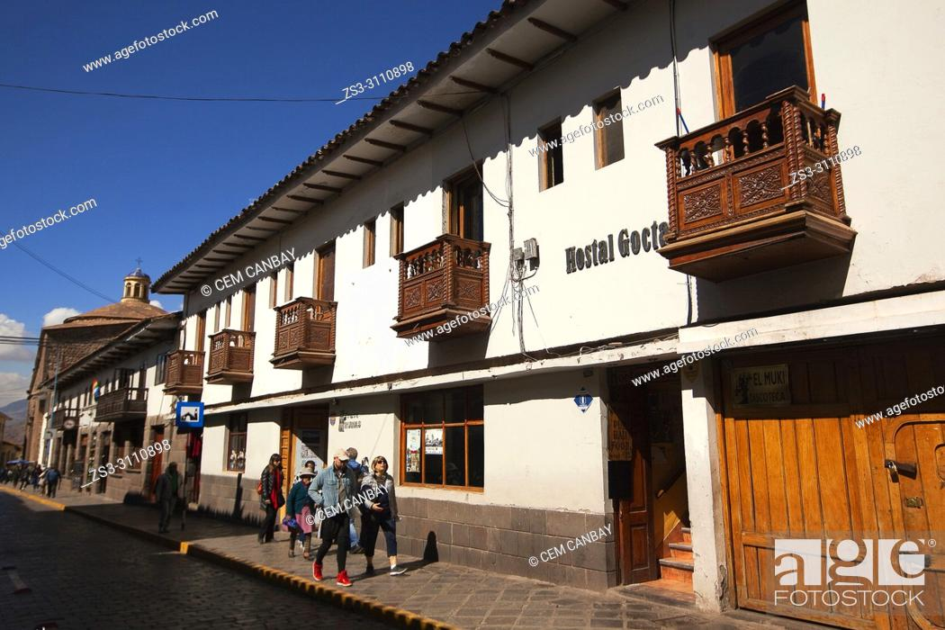 Stock Photo: Tourists in front of the colonial buildings with balconies at the historic center, Cusco, Peru, South America.