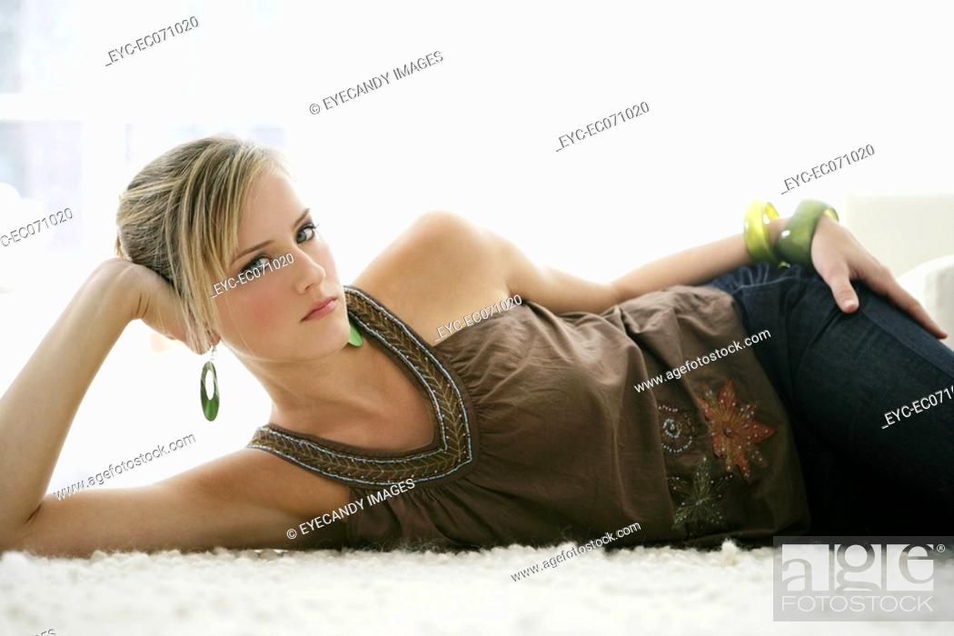 Stock Photo: Young stylish woman relaxing on floor.