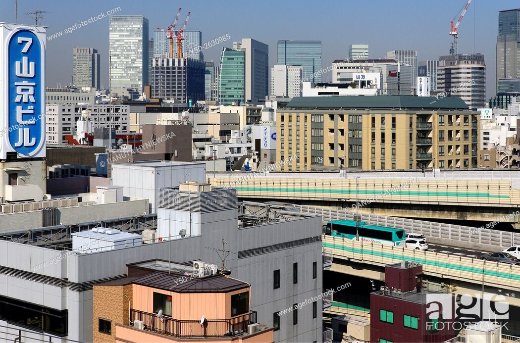 Stock Photo: Urban landscape, Metropolitan Expressways number 6 and 9 seen inside jungle of buildings, Chuo, Chuo-ku, Central Ward, Tokyo, Japan.