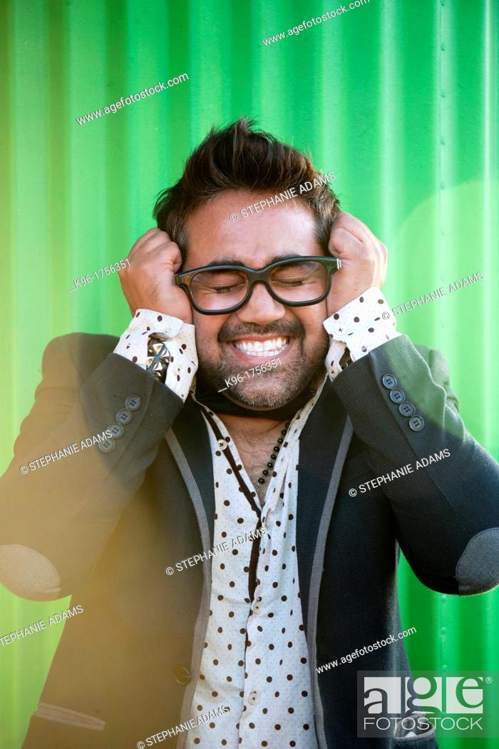 Stock Photo: A man with eyes closed in a comical expressive face.
