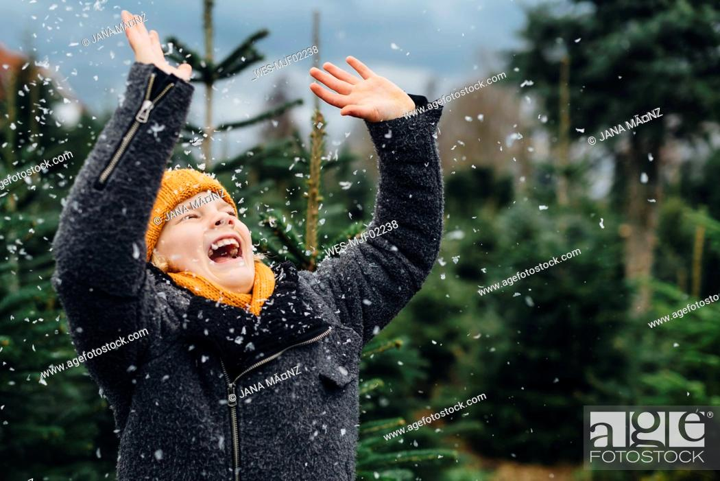 Stock Photo: Little boy having fun with snow before Christmas.