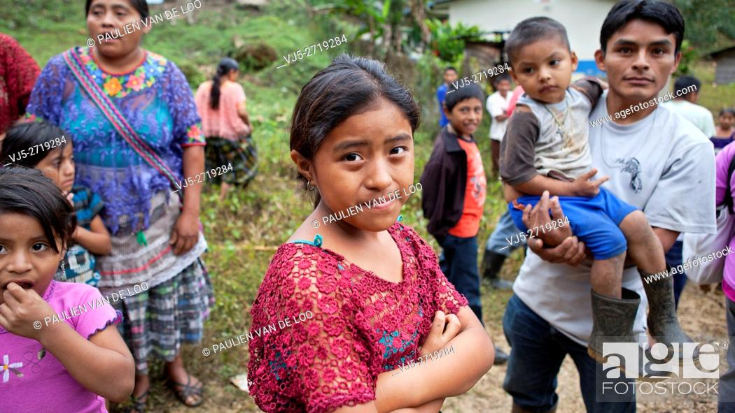 Stock Photo: Chahal, Guatemala, a maya tribe in the jngle of Guatemala. A curious father is watching his daughter and carrying his son.