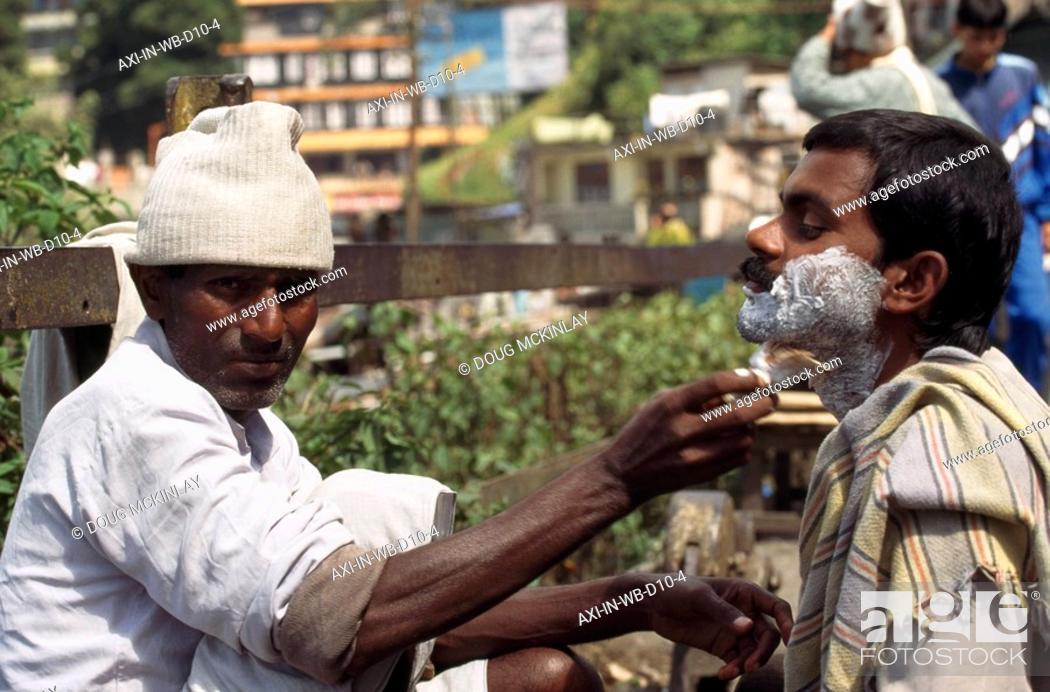 Stock Photo: Streetside shave , Darjeeling, India.