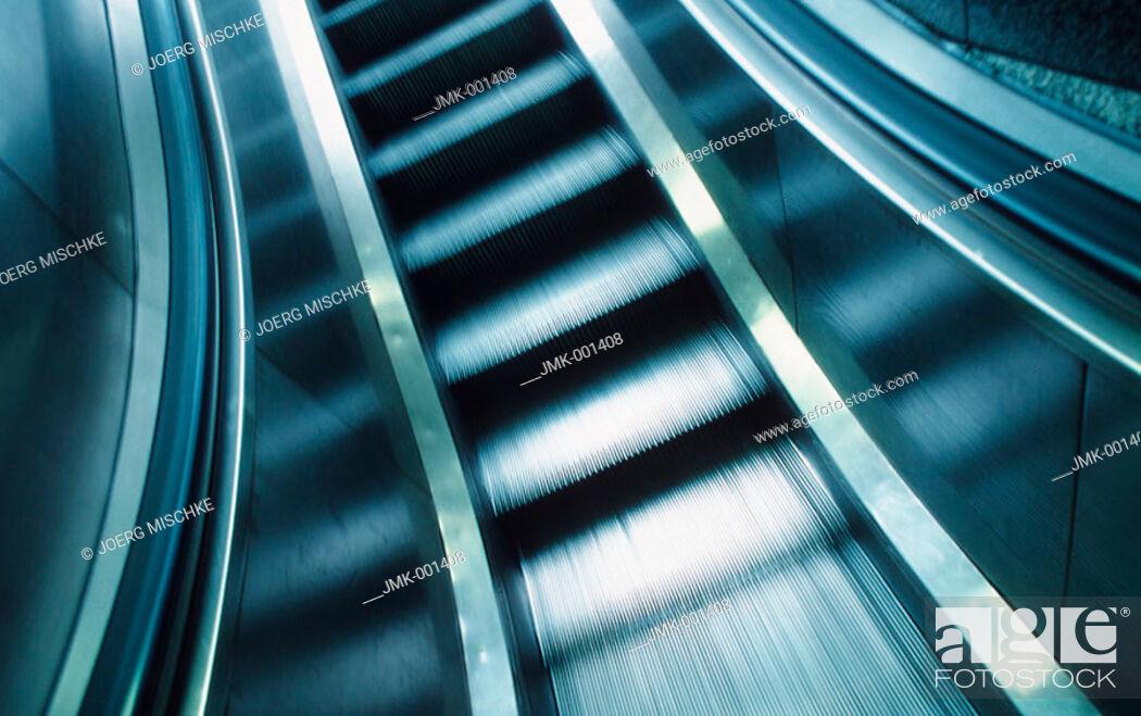 Stock Photo: An escalator, moving.