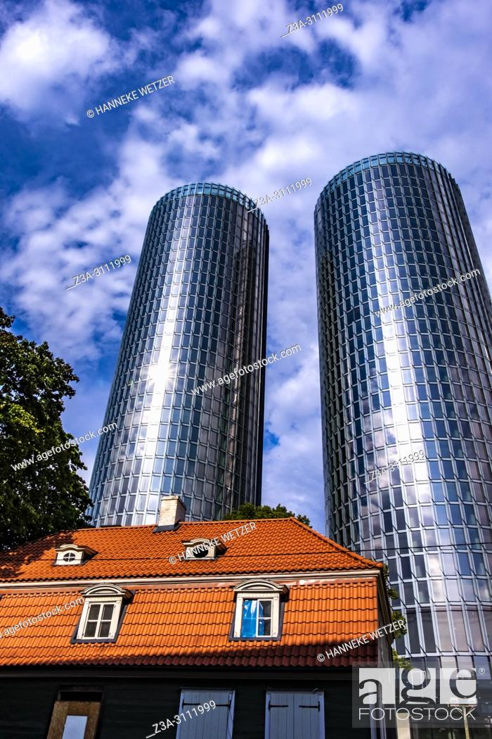 Stock Photo: Traditional house in front of the newly built Z-Towers in Riga, Latvia, Europe.
