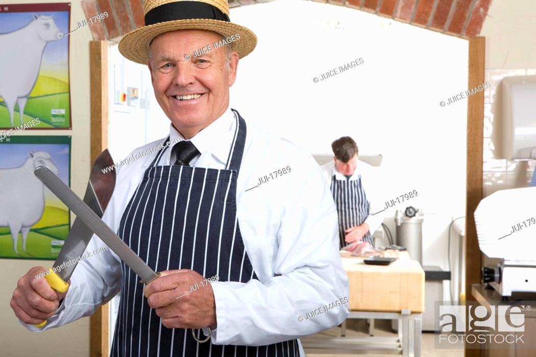 Stock Photo: Butcher in uniform sharpening knife.