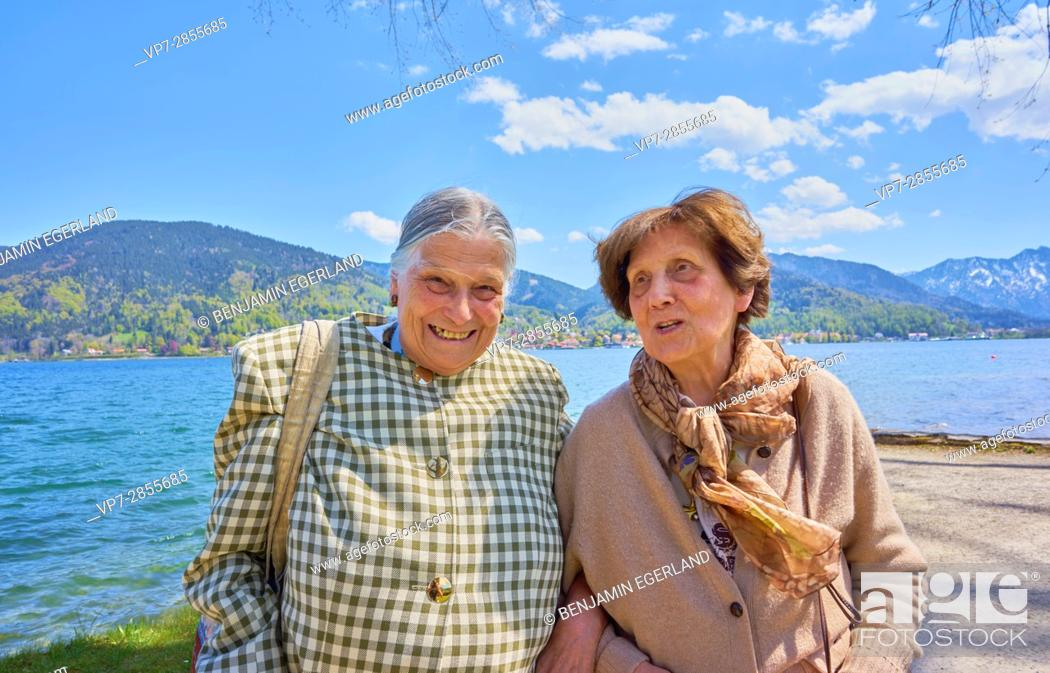 Stock Photo: Happy two woman having fun at lake Tegernsee, Bavaria, Germany.