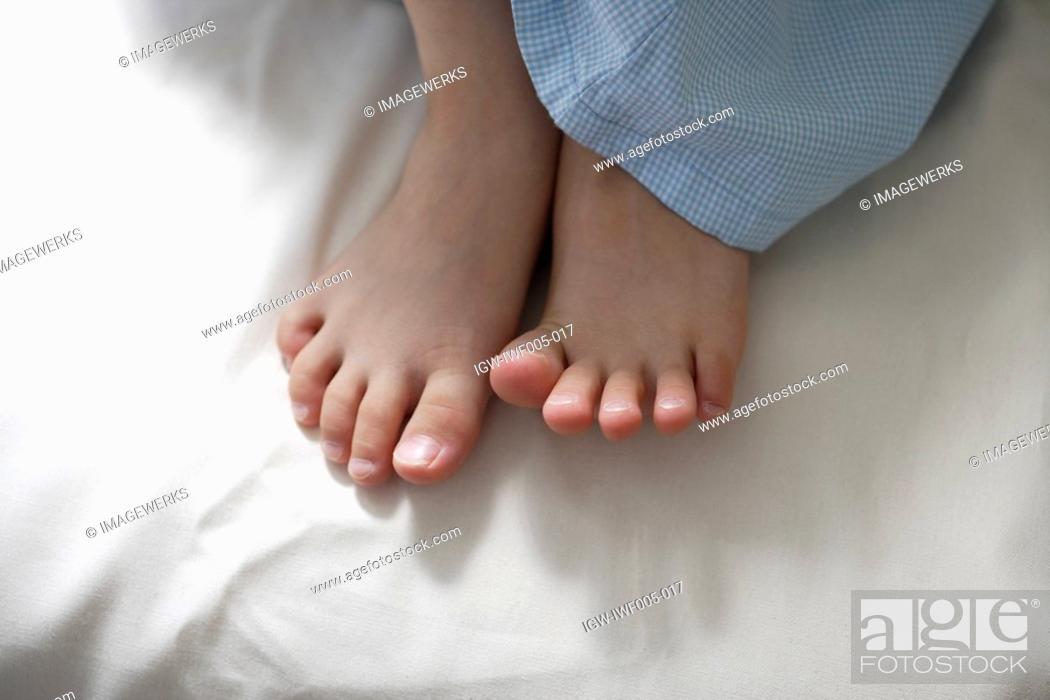 Stock Photo: Bear feet of child.