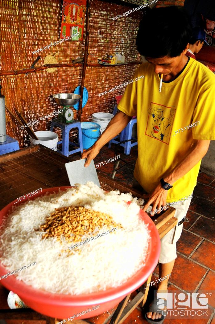 Stock Photo: Vietnam, Can Tho province, Mekong Delta, manufactures handmade rice cake.
