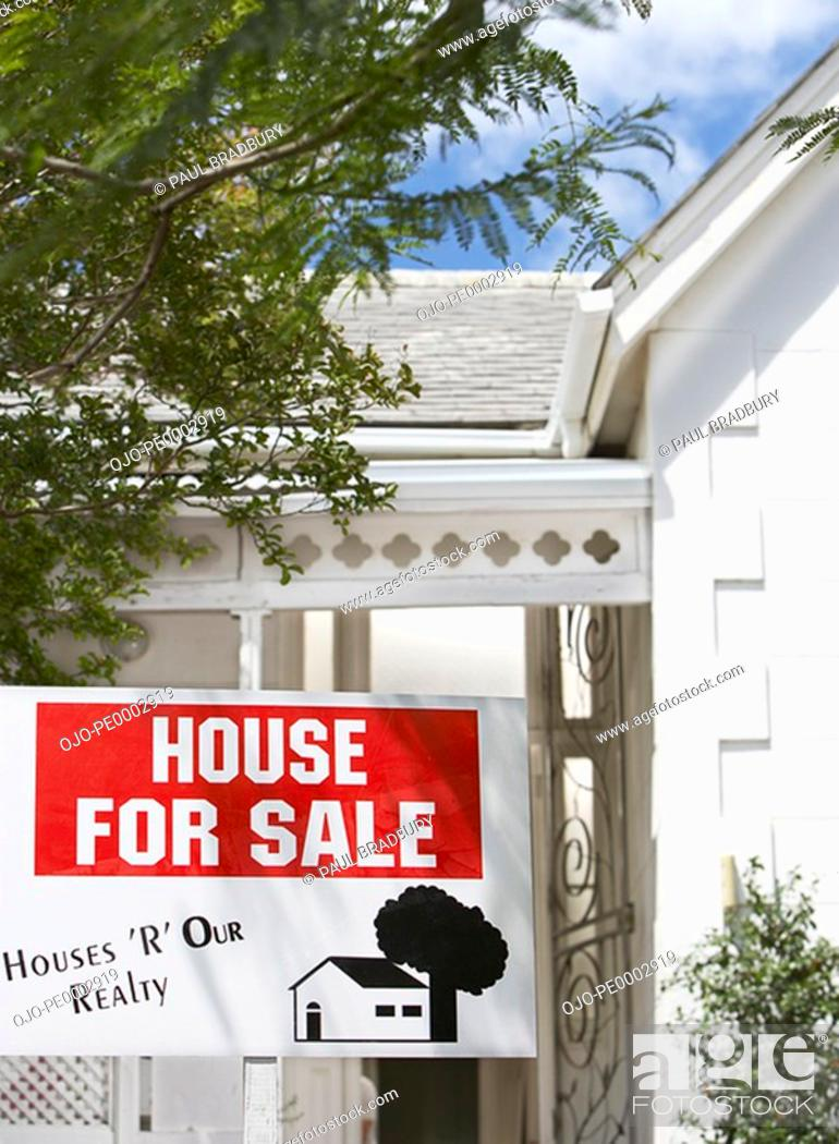 Stock Photo: House for sale sign outdoors with trees.