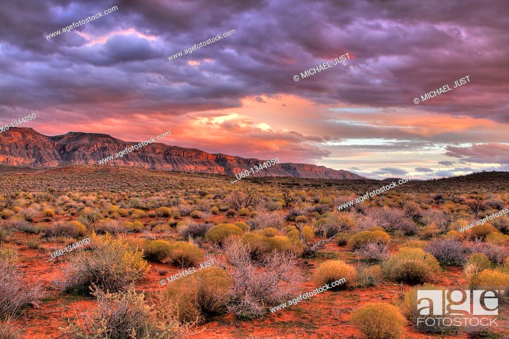 Stock Photo: The sun sets on the cliffs bordering Sand hollow in Southern Utah.