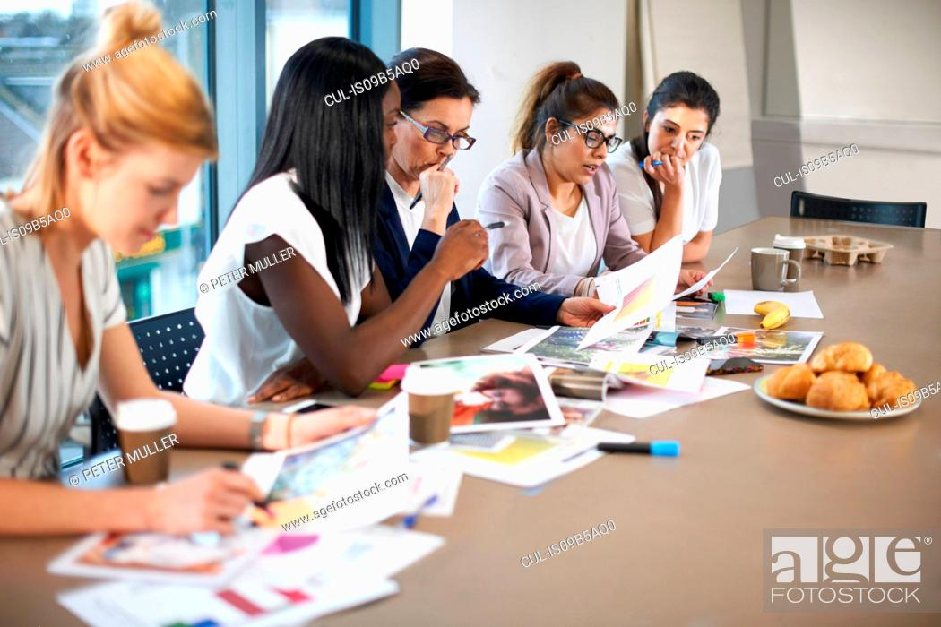 Stock Photo: Colleagues having meeting at conference room table.
