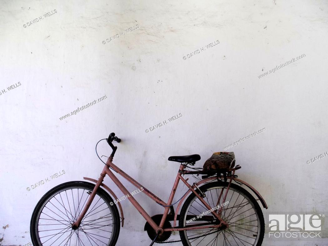 Stock Photo: Bicycle parked in front of a wall, Vitoria, Espirito Santo, Brazil.