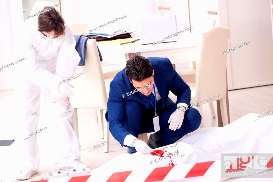 Stock Photo: Forensics investigator at the scene of office crime.