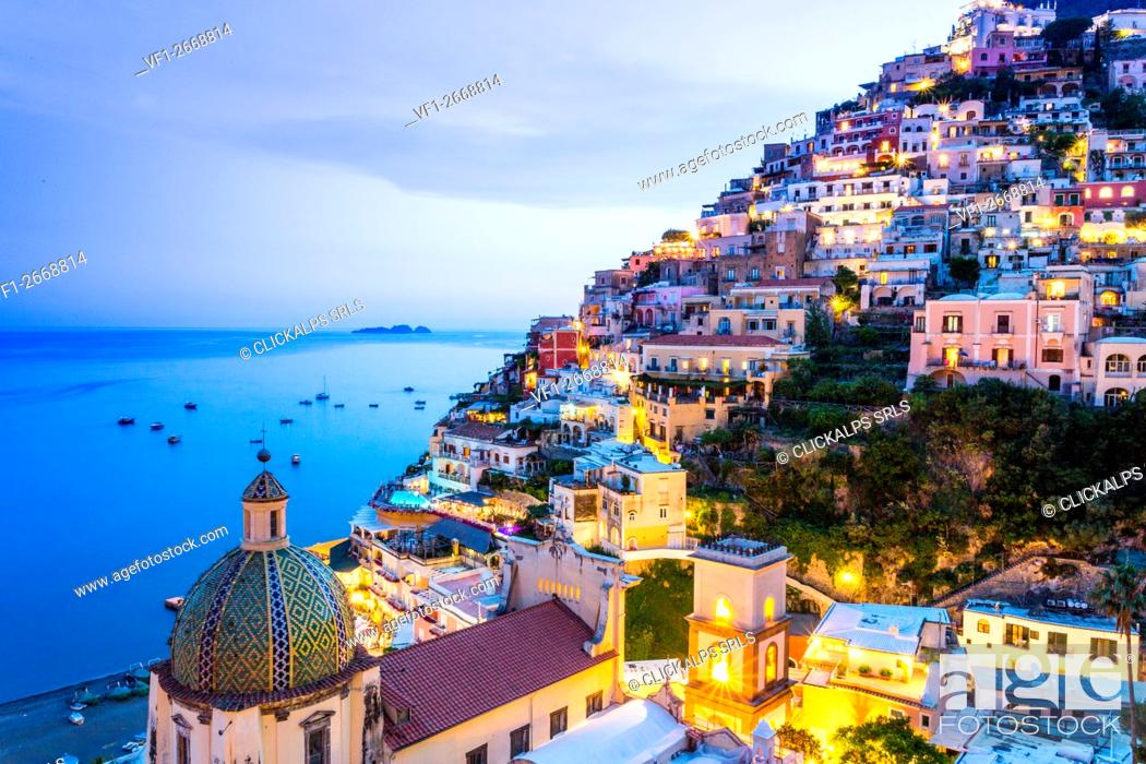 Imagen: Positano, Amalfi Coast, Campania, Sorrento, Italy. View of the town and the seaside in a summer sunset.