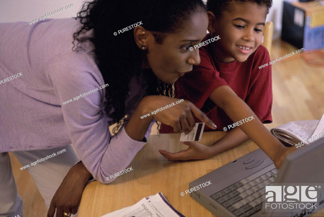 Stock Photo: Mother and her son in front of a laptop.