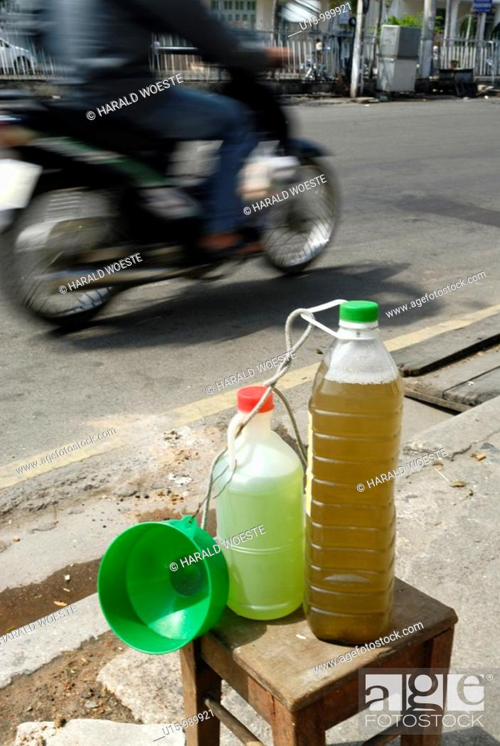 Stock Photo: Small volumes of petrol for the many small motorbikes are sold almost everywhere, Nha Trang, Vietnam.