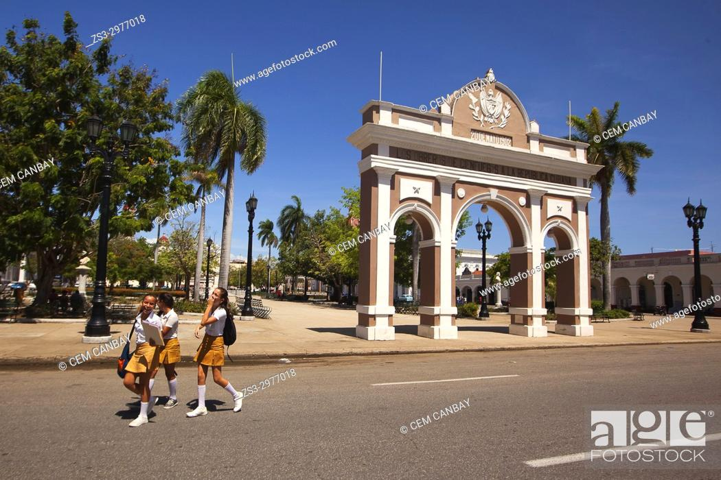 Stock Photo: Schoolgirls wearing uniforms in front of the Arch Of Triumph-Arco Del Triunfo at Parque Jose Marti in Plaza de Armas Square, Cienfuegos, Cuba, West Indies.