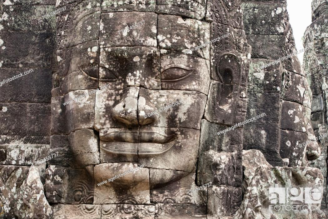 Stock Photo: Giant stone face at the Bayon temple at Angkor Wat in Siem Reap, Cambodia.