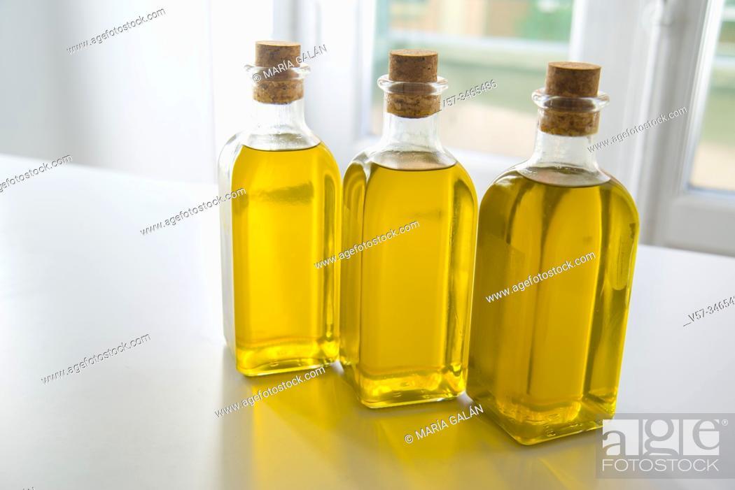 Stock Photo: Three oil bottles.
