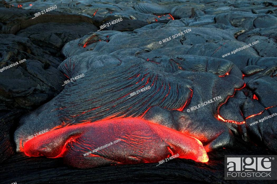 Stock Photo: Molten pahoehoe type lava flowing from a crack in the East Rift Zone towards the sea, lava field of the Kilauea shield volcano, Hawai'i Volcanoes National Park.