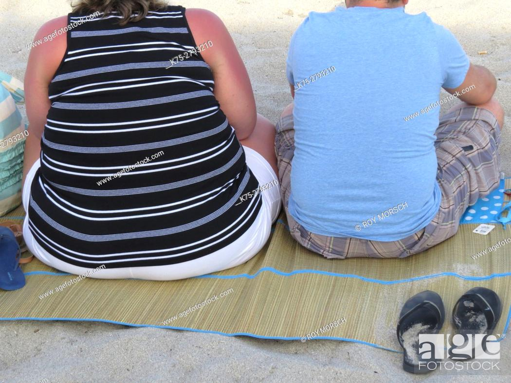 Stock Photo: Couple from behind sitting on mat.