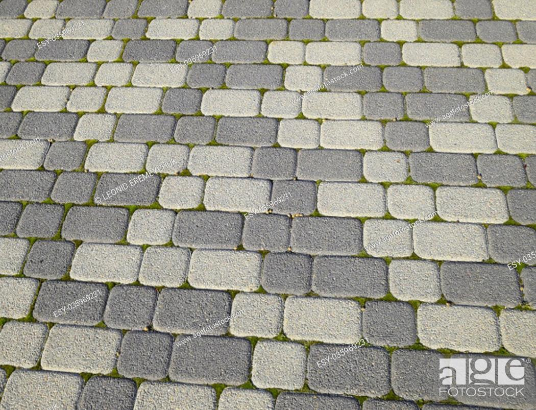 Stock Photo: Industrial building background of paving slabs with overgrown with moss in the cracks. Texturing background.