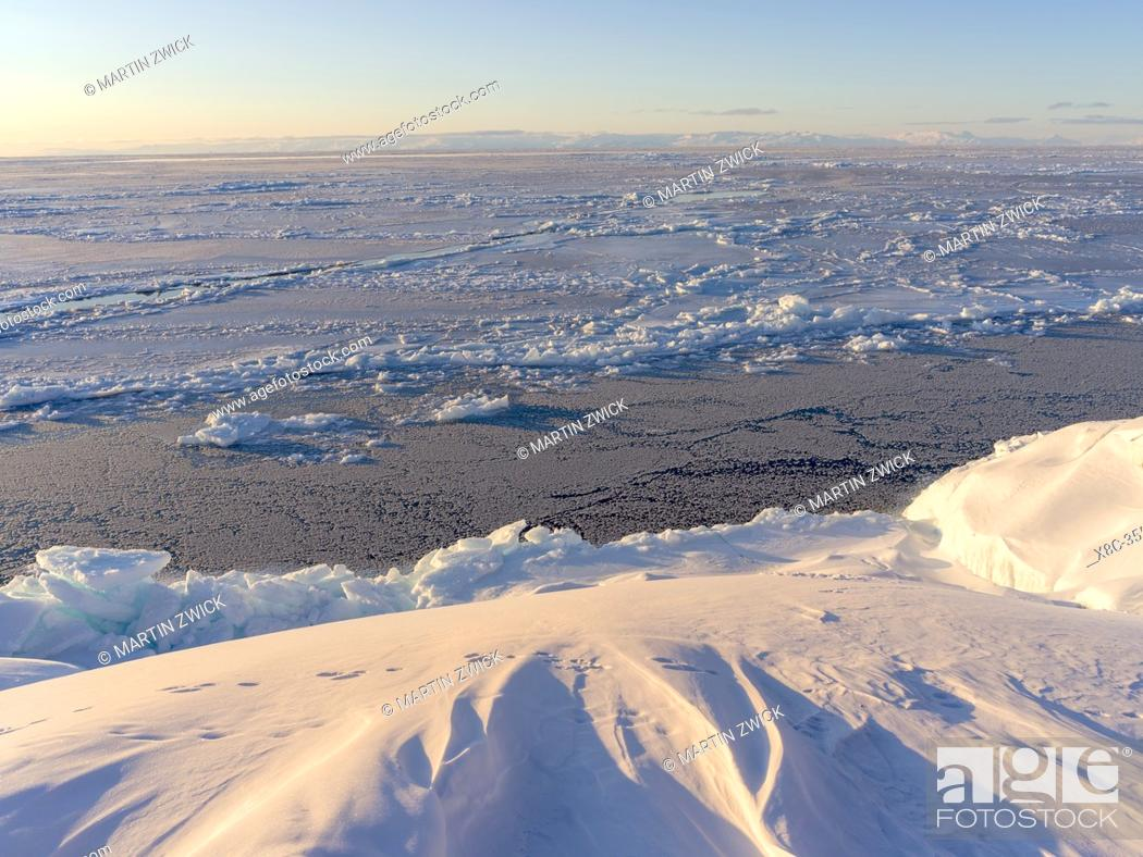 Stock Photo: Frozen Disko Bay during winter, West Greenland, Disko Island in the background. America, North America, Greenland, Denmark.