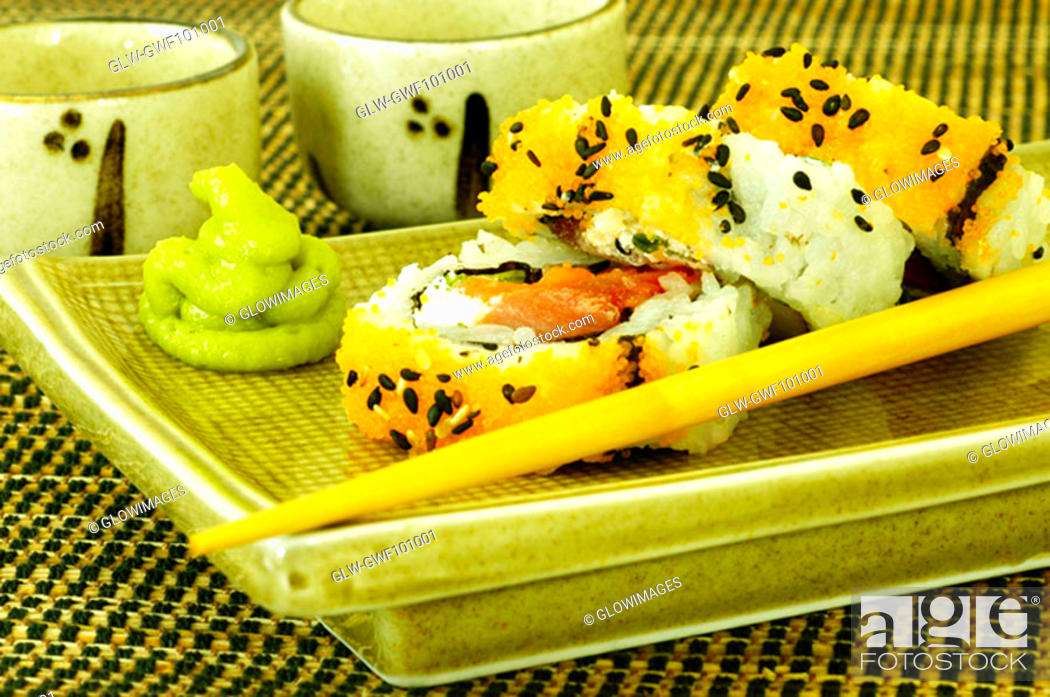 Stock Photo: Close-up of sushi on a serving tray.