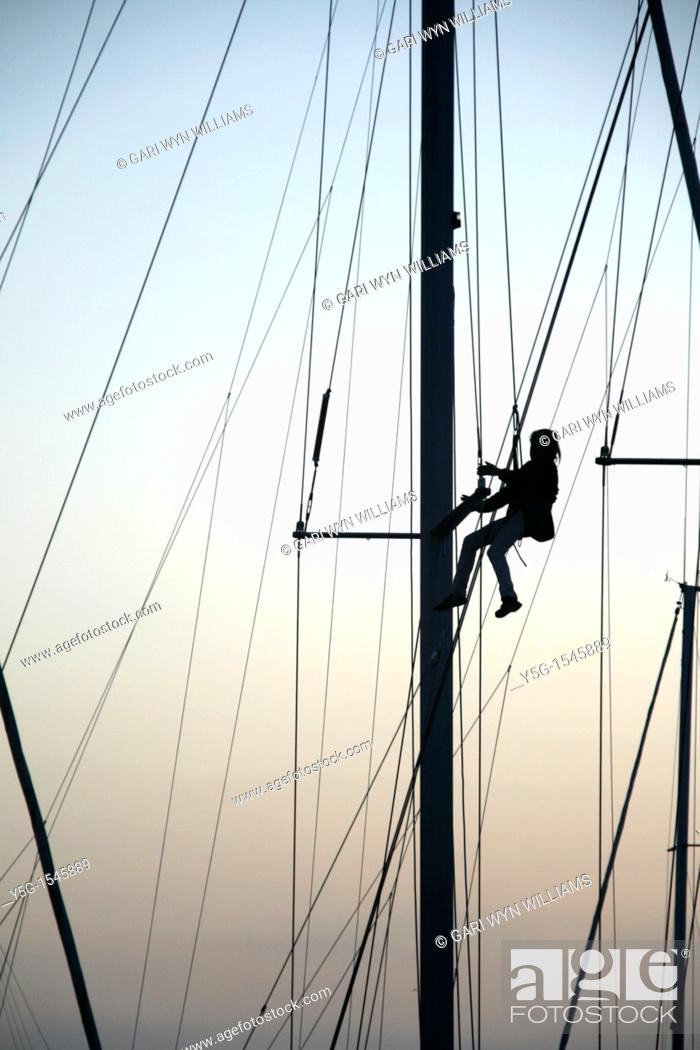 Stock Photo: person repairing yacht boat rigging.