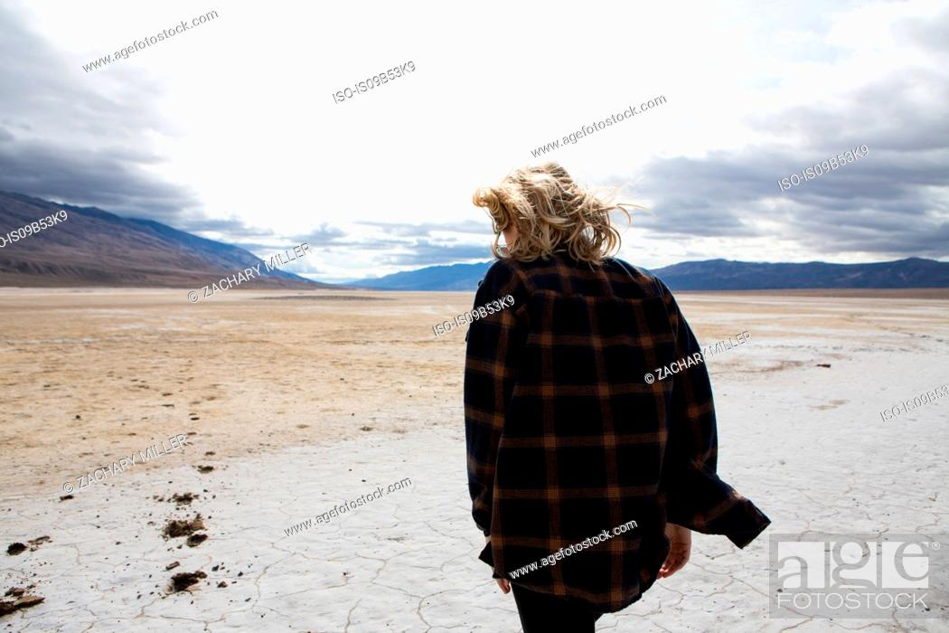 Stock Photo: Woman walking in Death Valley National Park, California, US.