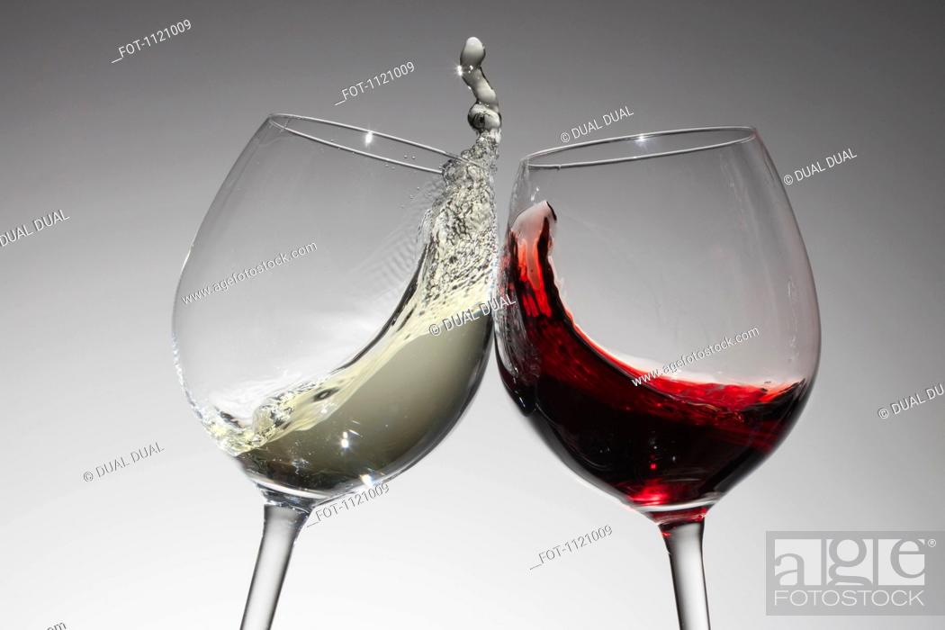 Stock Photo: Toasting with glasses of water and red wine.