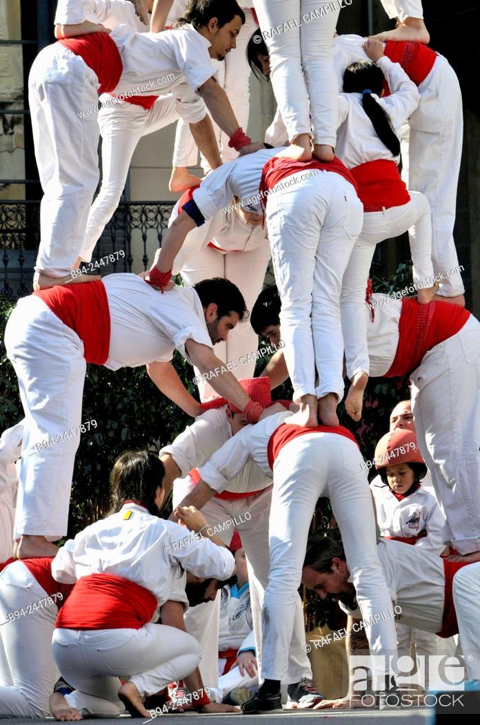 Stock Photo: Castell, human towers. February 12, Falcons group. Celebration of Saint Eulalia martyr, 290-303 AD. Canonized 633 AD. Copatron of Barcelona.