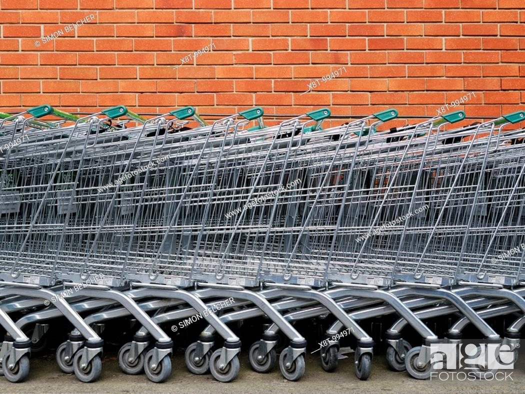 Stock Photo: Shopping Trolleys Outside a Supermarket.